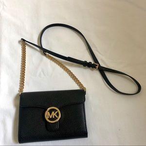 Black and gold cross body Michael kors bag